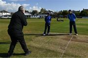 1 May 2021; Match referee Kevin Gallagher performs the coin toss in the company of North West Warriors captain Andy McBrine and Leinster Lightning captain George Dockrell before the Inter-Provincial Cup 2021 match between Leinster Lightning and North West Warriors at Pembroke Cricket Club in Dublin. Photo by Brendan Moran/Sportsfile