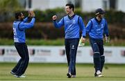 1 May 2021; George Dockrell of Leinster Lightning, centre, celebrates with teammate Simi Singh after taking the wicket of Stuart Thompson of North West Warriors during the Inter-Provincial Cup 2021 match between Leinster Lightning and North West Warriors at Pembroke Cricket Club in Dublin. Photo by Brendan Moran/Sportsfile