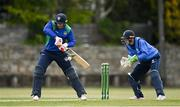 1 May 2021; Graham Hume of North West Warriors playes a shot watched by Leinster Lightning wicketkeeper Lorcan Tucker during the Inter-Provincial Cup 2021 match between Leinster Lightning and North West Warriors at Pembroke Cricket Club in Dublin. Photo by Brendan Moran/Sportsfile