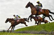 1 May 2021; Call It Magic, left, with Keith Donoghue up, jumps Ruby's Double, alongside Ballyboker Bridge, right, with Denis O'Regan up, on their way to winning the Dooley Insurance Group Cross Country Steeplechase during day five of the Punchestown Festival at Punchestown Racecourse in Kildare. Photo by Seb Daly/Sportsfile