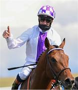 1 May 2021; Jockey Kevin Manning celebrates after riding Poetic Flare to victory in the Qipco 2000 Guineas Stakes at Newmarket Racecourse in Newmarket, England. Hugh Routledge /Sportsfile