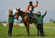 1 May 2021; Jockey Sean Flanagan celebrates with grooms Emma Murray, left, and Emma Connolly and Jeff Kidder after winning the Ballymore Champion Four Year Old Hurdle during day five of the Punchestown Festival at Punchestown Racecourse in Kildare. Photo by Seb Daly/Sportsfile