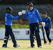1 May 2021; Simi Singh of Leinster Lightning, left, is congrautlated by team-mate George Dockrell, after hitting the winning runs during the Inter-Provincial Cup 2021 match between Leinster Lightning and North West Warriors at Pembroke Cricket Club in Dublin. Photo by Brendan Moran/Sportsfile