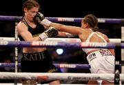 1 May 2021; Katie Taylor, left, in action against Natasha Jonas during their WBC, WBA, IBF and WBO female lightweight title fight at the Manchester Arena in Manchester, England. Photo by Mark Robinson / Matchroom Boxing via Sportsfile