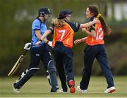 2 May 2021; Lara Maritz of Scorchers, right, is congratulated by teammate Ashlee King after claiming the wicket of Typhoons' Rebecca Stokell during the Arachas Super 50 Cup 2021 match between Typhoons and Scorchers at Pembroke Cricket Club in Dublin. Photo by Seb Daly/Sportsfile