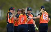 2 May 2021; Jenny Sparrow of Scorchers, 11, is congratulated by teammates after claiming the wicket of Typhoons' Amy Hunter during the Arachas Super 50 Cup 2021 match between Typhoons and Scorchers at Pembroke Cricket Club in Dublin. Photo by Seb Daly/Sportsfile