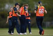 2 May 2021; Jenny Sparrow of Scorchers, centre, is congratulated by teammate Lara Maritz, left, after claiming the wicket of Typhoons' Amy Hunter during the Arachas Super 50 Cup 2021 match between Typhoons and Scorchers at Pembroke Cricket Club in Dublin. Photo by Seb Daly/Sportsfile