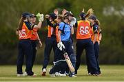2 May 2021; Orla Prendergast of Typhoons removes her helmet after being run out, as Scorchers players celebrate behind, during the Arachas Super 50 Cup 2021 match between Typhoons and Scorchers at Pembroke Cricket Club in Dublin. Photo by Seb Daly/Sportsfile