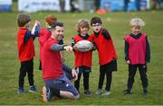 2 May 2021; Coach John Corrigan, with players, from left, Shay O'Riordan, Maxim Tadayeski and Alfie Jones, during Seapoint Minis rugby training at Seapoint RFC in Dublin. Photo by Ramsey Cardy/Sportsfile