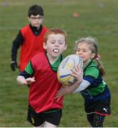 2 May 2021; Oisin Kennedy and Molly Corrigan during Seapoint Minis rugby training at Seapoint RFC in Dublin. Photo by Ramsey Cardy/Sportsfile