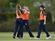 2 May 2021; Leah Paul of Scorchers, left, is congratulated by teammate Gaby Lewis after claiming the wicket of Typhoons' Rachel Delaney  during the Arachas Super 50 Cup 2021 match between Typhoons and Scorchers at Pembroke Cricket Club in Dublin. Photo by Seb Daly/Sportsfile