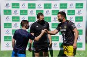 2 May 2021; Team captains Luke McGrath of Leinster and Romain Sazy of La Rochelle fist bump in the company of Matthew Carley before the Heineken Champions Cup semi-final match between La Rochelle and Leinster at Stade Marcel Deflandre in La Rochelle, France. Photo by Julien Poupart/Sportsfile