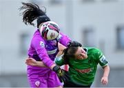2 May 2021; Treaty United goalkeeper Micheala Mitchell holds off Eleanor Ryan-Doyle of Peamount United as they contest the ball during the SSE Airtricity Women's National League match between Treaty United and Peamount United at Jackman Park in Limerick. Photo by Piaras Ó Mídheach/Sportsfile