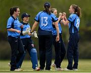 2 May 2021; Orla Prendergast of Typhoons, right, is congratulated by teammates after claiming the wicket of Typhoons' Cara Murray during the Arachas Super 50 Cup 2021 match between Typhoons and Scorchers at Pembroke Cricket Club in Dublin. Photo by Seb Daly/Sportsfile