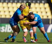2 May 2021; Andrew Porter, left, and Ed Byrne of Leinster tackle Grégory Alldritt of La Rochelle during the Heineken Champions Cup semi-final match between La Rochelle and Leinster at Stade Marcel Deflandre in La Rochelle, France. Photo by Julien Poupart/Sportsfile