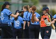 2 May 2021; Jenny Sparrow of Scorchers and Rebecca Stokell of Typhoons after the Arachas Super 50 Cup 2021 match between Typhoons and Scorchers at Pembroke Cricket Club in Dublin. Photo by Seb Daly/Sportsfile