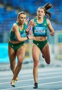 2 May 2021; Sharlene Mawdsley of Ireland, left, takes the baton from team-mate Phil Healy during their 4x400 metre final during the IAAF World Athletics Relays at the Merchant Slaski Stadium in Chorzow, Poland. Photo by Radoslaw Jozwiak/Sportsfile