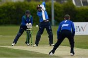 1 May 2021; George Dockrell of Leinster Lightning plays a shot watched by North West Warriors wicketkeeper Stephen Doheny during the Inter-Provincial Cup 2021 match between Leinster Lightning and North West Warriors at Pembroke Cricket Club in Dublin. Photo by Brendan Moran/Sportsfile