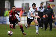 3 May 2021; Michael Duffy of Dundalk in action against Shane Elworthy of Longford Town during the SSE Airtricity League Premier Division match between Longford Town and Dundalk at Bishopsgate in Longford. Photo by Ramsey Cardy/Sportsfile