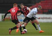 3 May 2021; Sean Murray of Dundalk is tackled by Aodh Dervin, left, and Dean Zambra of Longford Town during the SSE Airtricity League Premier Division match between Longford Town and Dundalk at Bishopsgate in Longford. Photo by Ramsey Cardy/Sportsfile