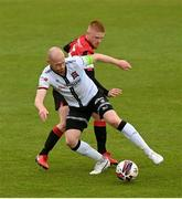 3 May 2021; Chris Shields of Dundalk in action against Aodh Dervin of Longford Town during the SSE Airtricity League Premier Division match between Longford Town and Dundalk at Bishopsgate in Longford. Photo by Ramsey Cardy/Sportsfile
