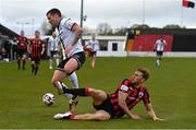 3 May 2021; Patrick McEleney of Dundalk is tackled by Aaron O'Driscoll of Longford Town during the SSE Airtricity League Premier Division match between Longford Town and Dundalk at Bishopsgate in Longford. Photo by Ramsey Cardy/Sportsfile