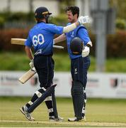 4 May 2021; George Dockrell of Leinster Lightning, right, is congratulated after scoring a 100 by team-mate Barry McCarthy during the Inter-Provincial Cup 2021 match between Leinster Lightning and Northern Knights at Pembroke Cricket Club in Dublin.  Photo by Matt Browne/Sportsfile