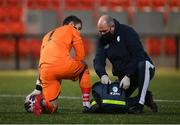 3 May 2021; Finn Harps physiotherapist Conall McFadden gives medical attention to Finn Harps goalkeeper Mark Anthony McGinley during the SSE Airtricity League Premier Division match between Derry City and Finn Harps at the Ryan McBride Brandywell Stadium in Derry. Photo by Stephen McCarthy/Sportsfile