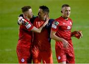 7 May 2021; Shelbourne players, from left, Kevin O'Connor, Brendan Clarke and Michael O'Connor celebrate following their side's victory in the SSE Airtricity League First Division match between Shelbourne and Athlone Town at Tolka Park in Dublin.  Photo by Harry Murphy/Sportsfile
