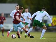 7 May 2021; Killian Cooper of Cobh Ramblers in action against Luke McWilliams of Cabinteely during the SSE Airtricity League First Division match between Cabinteely and Cobh Ramblers at Stradbrook Park in Blackrock, Dublin.  Photo by Eóin Noonan/Sportsfile