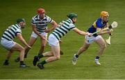 8 May 2021; Jake Morris of Tipperary in action against Limerick players, from left, Seán Finn, Barry Nash and William O'Donoghue during the Allianz Hurling League Division 1 Group A Round 1 match between Limerick and Tipperary at LIT Gaelic Grounds in Limerick. Photo by Stephen McCarthy/Sportsfile