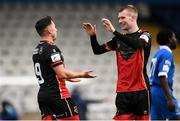8 May 2021; Chris Lyons of Drogheda United celebrates after scoring his side's fourth goal with team-mate Mark Doyle, right, during the SSE Airtricity League Premier Division match between Waterford and Drogheda United at RSC in Waterford. Photo by Ben McShane/Sportsfile