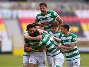 8 May 2021; Danny Mandroiu of Shamrock Rovers, centre, celebrates with team-mates including Lee Grace, top, after scoring his side's second goal with team-mates during the SSE Airtricity League Premier Division match between St Patrick's Athletic and Shamrock Rovers at Richmond Park in Dublin. Photo by Harry Murphy/Sportsfile