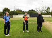 9 May 2021; Match referee Phil Thompson tosses the coin watched by captains Orla Prendergast of Typhoons and Leah Paul of Scorchers before the third match of the Arachas Super 50 Cup between Scorchers and Typhoons at Rush Cricket Club in Rush, Dublin. Photo by Harry Murphy/Sportsfile