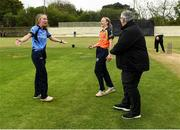 9 May 2021; Captains Orla Prendergast of Typhoons and Leah Paul of Scorchers share a joke with match referee Phil Thompson before the third match of the Arachas Super 50 Cup between Scorchers and Typhoons at Rush Cricket Club in Rush, Dublin. Photo by Harry Murphy/Sportsfile