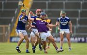 9 May 2021; Kevin Foley of Wexford takes the hurley of Sean Downey of Laois during the Allianz Hurling League Division 1 Group B Round 1 match between Wexford and Laois at Chadwicks Wexford Park in Wexford. Photo by Brendan Moran/Sportsfile