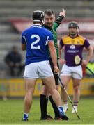 9 May 2021; Referee Thomas Walsh indicates for Lee Cleere of Laois to leave the pitch and go to the sin bin after showing him a yellow card during the Allianz Hurling League Division 1 Group B Round 1 match between Wexford and Laois at Chadwicks Wexford Park in Wexford. Photo by Brendan Moran/Sportsfile