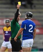 9 May 2021; Referee Thomas Walsh shows a yellow card to Lee Cleere of Laois and indicates for him to leave the pitch and go to the sin bin during the Allianz Hurling League Division 1 Group B Round 1 match between Wexford and Laois at Chadwicks Wexford Park in Wexford. Photo by Brendan Moran/Sportsfile