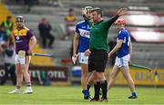 9 May 2021; Referee Thomas Walsh signals for a penalty after Rory O'Connor of Wexford was fouled by Lee Cleere of Laois (not pictured) during the Allianz Hurling League Division 1 Group B Round 1 match between Wexford and Laois at Chadwicks Wexford Park in Wexford. Photo by Brendan Moran/Sportsfile
