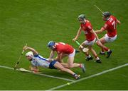 9 May 2021; Jack Fagan of Waterford in action against Cork players, from left, Sean O'Donoghue, Mark Coleman and Niall Cashman during the Allianz Hurling League Division 1 Group A Round 1 match between Cork and Waterford at Páirc Ui Chaoimh in Cork. Photo by Stephen McCarthy/Sportsfile