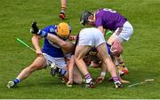 9 May 2021; Players from both sides, Kevin Foley and Diarmuid O'Keeffe, right, of Wexford and Charlie Dwyer, left, and Ciaran Collier of Laois compete for possession of the sliotar during the Allianz Hurling League Division 1 Group B Round 1 match between Wexford and Laois at Chadwicks Wexford Park in Wexford. Photo by Brendan Moran/Sportsfile