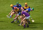 9 May 2021; Players from both sides, including Conor Hearne, Kevin Foley, Conal Flood and Simon Donohoe of Wexford and Charlie Dwyer, Paddy Purcell and Roddy King of Laois compete for possession of the sliotar during the Allianz Hurling League Division 1 Group B Round 1 match between Wexford and Laois at Chadwicks Wexford Park in Wexford. Photo by Brendan Moran/Sportsfile