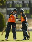 9 May 2021; Lara Maritz of Scorchers fistbumbs batting partner Anna Kerrison after hitting a boundary during the third match of the Arachas Super 50 Cup between Scorchers and Typhoons at Rush Cricket Club in Rush, Dublin. Photo by Harry Murphy/Sportsfile