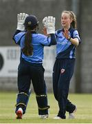 9 May 2021; Orla Prendergast of Typhoons, right, celebrates running out Jenny Sparrow of Scorchers with wicketkeeper Amy Hunter during the third match of the Arachas Super 50 Cup between Scorchers and Typhoons at Rush Cricket Club in Rush, Dublin. Photo by Harry Murphy/Sportsfile