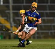 8 May 2021; Barry Heffernan of Tipperary in action against Séamus Flanagan of Limerick during the Allianz Hurling League Division 1 Group A Round 1 match between Limerick and Tipperary at LIT Gaelic Grounds in Limerick. Photo by Ray McManus/Sportsfile