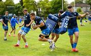 10 May 2021; Scott Penny breaks through the tackle by Vakh Abdaladze and Dan Sheehan during Leinster Rugby squad training at UCD in Dublin. Photo by Ramsey Cardy/Sportsfile
