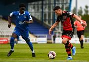8 May 2021; Chris Lyons of Drogheda United and Lekan Oki of Waterford during the SSE Airtricity League Premier Division match between Waterford and Drogheda United at RSC in Waterford. Photo by Ben McShane/Sportsfile