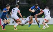 14 May 2021; Robbie Henshaw of Leinster is tackled by  Billy Burns, left, and Nick Timoney of Ulster during the Guinness PRO14 Rainbow Cup match between Leinster and Ulster at the RDS Arena in Dublin. Photo by Ramsey Cardy/Sportsfile