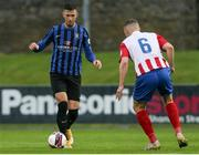 14 May 2021; Stephen Meaney of Athlone Town in action against Anthony O'Donnell of Treaty United during the SSE Airtricity League First Division match between Treaty United and Athlone Town at Markets Field in Limerick. Photo by Michael P Ryan/Sportsfile