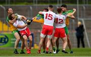 15 May 2021; Donegal players, from left, Neil McGee, Peadar Mogan and Brendan McCole tussle with Tyrone players, from left, Michael O'Neill, Richard Donnelly and Conor Meyler during the Allianz Football League Division 1 North Round 1 match between Tyrone and Donegal at Healy Park in Omagh, Tyrone. Photo by Stephen McCarthy/Sportsfile